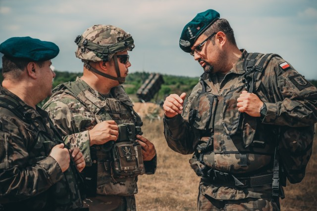 Chief Warrant Officer 2 Eric Land assigned to 5th Battalion, 7th Air Defense Regiment from Baumholder, Germany, informs the Polish Air Defense Artillery officers of the highlights of the new patriot missile system near Drawsko Pomorskiego, Poland, June 4, 2018. Having never before been this close to a U.S. patriot missile defense system before, the Polish Land Forces took in the opportunity to ask questions regarding the new systems capabilities.