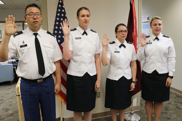 New physicians arriving for their graduate medical education at Madigan Army Medical Center on Joint Base Lewis-McChord, Washington, take the oath of office June 1. This year's class has 71 physicians.