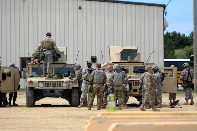 Soldiers on post for training in Operation Cold Steel II prepare for a training event May 10, 2018, at Fort McCoy, Wis. Operation Cold Steel II began in mid-February 2018. According to exercise planners, Operation Cold Steel II operations at Fort McCoy for 2018 falls under Task Force Triad. The task force, hosted by the 416th Theater Engineer Command, holds training through May 31 in which more than 3,000 Soldiers, or approximately 1,000 crews, are expected to attend the mounted crew-served weapons qualification training. (U.S. Army Photo by Scott T. Sturkol, Public Affairs Office, Fort McCoy, Wis.)