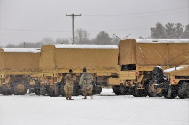 Soldiers at Fort McCoy, Wis., for training in the Operation Cold Steel II exercise prepare for a training scenario on a snowy day April 3, 2018, at Fort McCoy, Wis. Operation Cold Steel II is a validation exercise to ensure Army Reserve units and Soldiers are trained and ready to deploy on short notice as part of Ready Force X, according to the Army Reserve. Cold Steel II's Task Force Triad, hosted by the 416th Theater Engineer Command, is conducting training at Fort McCoy through May 31. More than 3,000 Soldiers are attending this mounted crew-served weapons qualification training. The Cold Steel II training has a daily presence on the Fort McCoy Range Complex, especially at several live-fire ranges. (U.S. Army Photo by Scott T. Sturkol, Public Affairs Office, Fort McCoy, Wis.)
