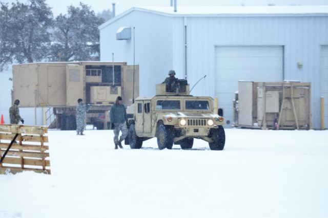 Soldiers at Fort McCoy, Wis., for training in the Operation Cold Steel II exercise prepare for a training scenario on a snowy day April 3, 2018, at Range 26 at Fort McCoy, Wis. Operation Cold Steel II is a validation exercise to ensure Army Reserve units and Soldiers are trained and ready to deploy on short notice as part of Ready Force X, according to the Army Reserve. Cold Steel II's Task Force Triad, hosted by the 416th Theater Engineer Command, is conducting training at Fort McCoy through May 31. More than 3,000 Soldiers are attending this mounted crew-served weapons qualification training. The Cold Steel II training has a daily presence on the Fort McCoy Range Complex, especially at several live-fire ranges. (U.S. Army Photo by Scott T. Sturkol, Public Affairs Office, Fort McCoy, Wis.)