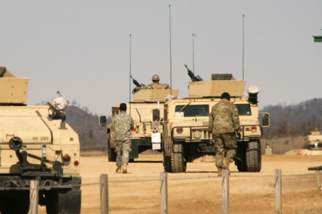 Soldiers at Fort McCoy, Wis., for training in Operation Cold Steel II prepare for a training session at Range 26 on March 22, 2018, at the installation. Operation Cold Steel II is the Army Reserve's crew-served weapons qualification and validation exercise to ensure America's Army Reserve units and Soldiers are trained and ready to deploy on short notice as part of Ready Force X. Cold Steel II's Task Force Triad, hosted by the 416th Theater Engineer Command, will conduct training at Fort McCoy through May 31. More than 3,000 Soldiers are attending this mounted crew-served weapons qualification training. (U.S. Army Photo by Scott T. Sturkol, Public Affairs Office, Fort McCoy, Wis.)