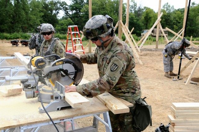 Soldiers with the Army Reserve's 327th Engineer Company of Onalaska, Wis., work on a troop project near Range 2 on Aug. 16, 2017, at Fort McCoy, Wis. Completing troops projects at then installation is very important, according to Fort McCoy's Directorate of Public Works. The projects help troops get the training they need, and the post benefits from the work they do, such as improving Fort McCoy training ranges and quality-of-life programs. (U.S. Army Photo by Scott T. Sturkol, Public Affairs Office, Fort McCoy, Wis.)