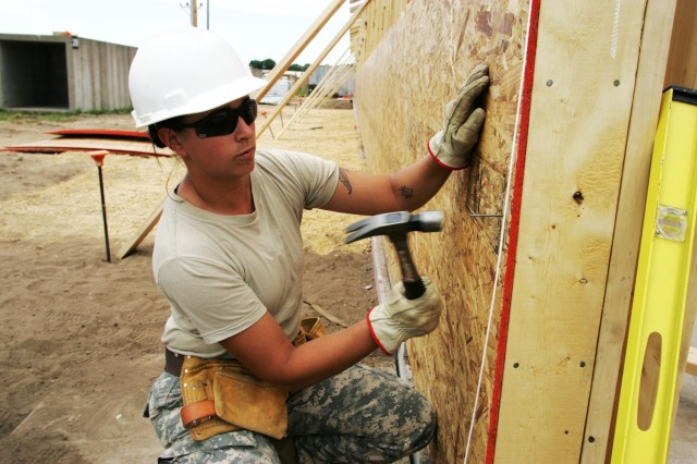 Spc. Kimberly Schuch, a Soldier with the Wisconsin National Guard's 829th Engineer Company (Vertical) of Ashland and Spooner, Wis., works on a shower facility June 22, 2016, at Improved Tactical Training Base Freedom on Fort McCoy's South Post. The company started the troop project from the ground up and worked on it over the course of four weeks in June 2016 as part of annual training. (U.S. Army Photo by Scott T. Sturkol, Public Affairs Office, Fort McCoy, Wis.)