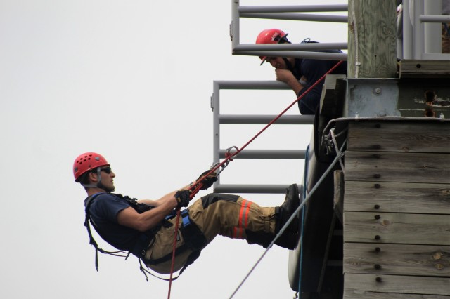 Firefighters with the Directorate of Emergency Services (DES) Fire Department practice rappelling down a tower May 10, 2018, at the Air Assault Course at Fort McCoy, Wis., during Ropes Rescue I training. The course is the first of many for the firefighters in technical rescue training. The DES Fire Department stepped up the department's training in technical rescue in 2014. Technical rescue is defined as those aspects of saving life or property that employ the use of tools and skills that exceed those normally used in firefighting, medical emergency, and rescue. (U.S. Army Photo by Scott T. Sturkol, Public Affairs Office, Fort McCoy, Wis.)