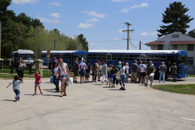 Visitors wait to take a bus tour during the Fort McCoy Armed Forces Day Open House on May 19, 2018, at Fort McCoy, Wis. An estimated 4,000 people or more attended the open house. The open house was held on the grounds of Fort McCoy's historic Commemorative Area, which includes World War II-era buildings, the Equipment Park, and Veterans Memorial Plaza. People lined up for camouflage face painting, personalized ID tags, an interactive-marksmanship gallery, and military-vehicle and fire-truck displays. They also saw the latest Army medical equipment in use, filled sandbags to build a mock defensive position, and more. (U.S. Army Photo by Scott T. Sturkol, Public Affairs Office, Fort McCoy, Wis.)