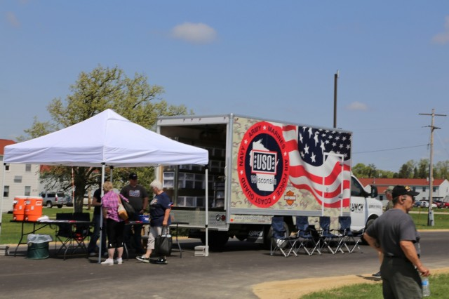 Visitors stop by vehicle displays and other attractions during the Fort McCoy Armed Forces Day Open House on May 19, 2018, at Fort McCoy, Wis. An estimated 4,000 people or more attended the open house. The open house was held on the grounds of Fort McCoy's historic Commemorative Area, which includes World War II-era buildings, the Equipment Park, and Veterans Memorial Plaza. People lined up for camouflage face painting, personalized ID tags, an interactive-marksmanship gallery, and military-vehicle and fire-truck displays. They also saw the latest Army medical equipment in use, filled sandbags to build a mock defensive position, and more. (U.S. Army Photo by Scott T. Sturkol, Public Affairs Office, Fort McCoy, Wis.)
