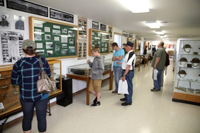 Visitors stop by History Center during the Fort McCoy Armed Forces Day Open House on May 19, 2018, at Fort McCoy, Wis. An estimated 4,000 people or more attended the open house. The open house was held on the grounds of Fort McCoy's historic Commemorative Area, which includes World War II-era buildings, the Equipment Park, and Veterans Memorial Plaza. People lined up for camouflage face painting, personalized ID tags, an interactive-marksmanship gallery, and military-vehicle and fire-truck displays. They also saw the latest Army medical equipment in use, filled sandbags to build a mock defensive position, and more. (U.S. Army Photo by Scott T. Sturkol, Public Affairs Office, Fort McCoy, Wis.)