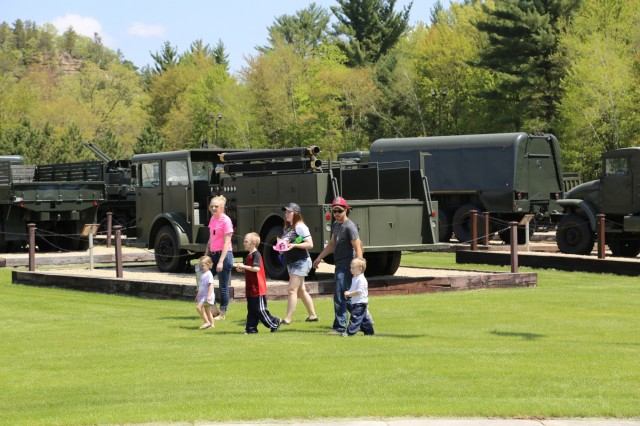 Visitors stop by Equipment Park during the Fort McCoy Armed Forces Day Open House on May 19, 2018, at Fort McCoy, Wis. An estimated 4,000 people or more attended the open house. The open house was held on the grounds of Fort McCoy's historic Commemorative Area, which includes World War II-era buildings, the Equipment Park, and Veterans Memorial Plaza. People lined up for camouflage face painting, personalized ID tags, an interactive-marksmanship gallery, and military-vehicle and fire-truck displays. They also saw the latest Army medical equipment in use, filled sandbags to build a mock defensive position, and more. (U.S. Army Photo by Scott T. Sturkol, Public Affairs Office, Fort McCoy, Wis.)