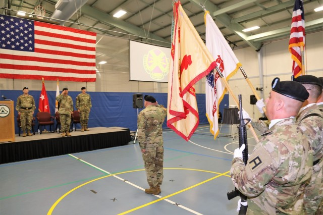 Garrison Commander Col. Hui Chae Kim salutes the color guard as the new commander at the end of a Fort McCoy Garrison change-of-command ceremony May 19, 2018, at Rumpel Fitness Center at the installation. Kim took command of the garrison from Col. David J. Pinter Sr. Installation Management Command-Readiness Director Brenda Lee McCullough presided over the ceremony. The change-of-command ceremony took place at the same time as the 2018 Armed Forces Day Open House at the installation. (U.S. Army Photo by Scott T. Sturkol, Public Affairs Office, Fort McCoy, Wis.)