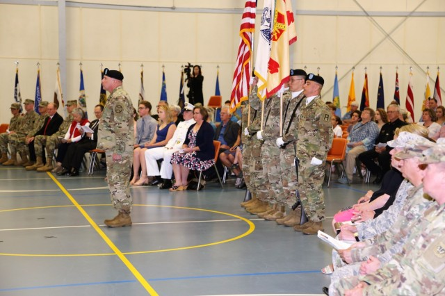The audience and color guard are shown during the Fort McCoy Garrison change-of-command ceremony May 19, 2018, at Fort McCoy, Wis. Col. Hui Chae Kim took command of the garrison from Col. David J. Pinter Sr. The change-of-command ceremony took place at the same time as the 2018 Armed Forces Day Open House at the installation. (U.S. Army Photo by Nick Radloff, Multi-Media/Visual Information Office, Directorate of Plans, Training, Mobilization and Security, Fort McCoy, Wis.)