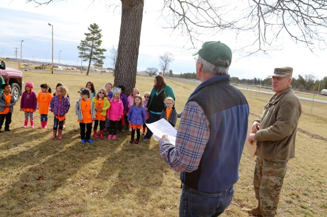 Forester James Kerkman with the Forestry Office of the Directorate of Public Works Environmental Division Natural Resources Branch talks with students and staff with the Child Development Center and others during an Arbor Day observance April 27, 2018, at Fort McCoy, Wis. Dozens of adults and children from the Fort McCoy community participated in the installation's 30th observance of Arbor Day with the planting of more than 400 trees on the cantonment area. The installation ceremony included not only the planting of 415 trees, but also the reading of the Arbor Day proclamation and the presentation of the installation's 29th consecutive Tree City USA award. (U.S. Army Photo by Scott T. Sturkol, Public Affairs Office, Fort McCoy, Wis.)