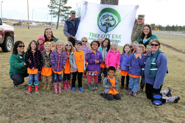 Forester James Kerkman and Garrison Commander Col. David J. Pinter Sr. hold up the Tree City USA flag on April 27, 2018, with students and staff with the Child Development Center during the Fort McCoy, Wis., observance of Arbor Day. Dozens of adults and children from the Fort McCoy community participated in the installation's 30th observance of Arbor Day with the planting of more than 400 trees on the cantonment area. The installation ceremony included not only the planting of 415 trees, but also the reading of the Arbor Day proclamation and the presentation of the installation's 29th consecutive Tree City USA award. (U.S. Army Photo by Scott T. Sturkol, Public Affairs Office, Fort McCoy, Wis.)