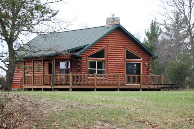 One of the existing cabins at Pine View Campground is shown May 2, 2018, at Fort McCoy, Wis. Construction on an additional 10 cabins begins in 2018. Once completed, the new cabins are expected to be a popular getaway for customers. Open year-round, Pine View Campground is part of Pine View Recreation Area. This area also includes Whitetail Ridge and Sportsman's Range. The campground is nestled in a wooded area about a quarter mile west of Fort McCoy's cantonment area and is bounded by Suukjak Sep Lake on the east and the La Crosse River on the west and south. (U.S. Army Photo by Scott T. Sturkol, Public Affairs Office, Fort McCoy, Wis.)