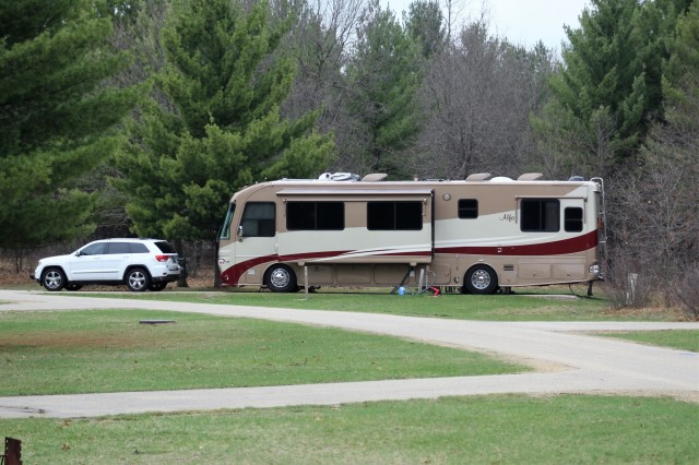 A recreational vehicle is parked May 2, 2018, at Pine View Campground at Fort McCoy, Wis. Open year-round, Pine View Campground is part of Pine View Recreation Area. This area also includes Whitetail Ridge and Sportsman's Range. The campground is nestled in a wooded area about a quarter mile west of Fort McCoy's cantonment area and is bounded by Suukjak Sep Lake on the east and the La Crosse River on the west and south. (U.S. Army Photo by Scott T. Sturkol, Public Affairs Office, Fort McCoy, Wis.)