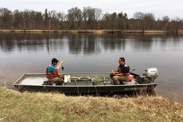 Watershed management biologists Derek Maki and Steve Rood with the Colorado State University conduct a fish survey at Swamp Pond on April 30, 2018, at Fort McCoy, Wis. The fish surveys, according to Fisheries Biologist John Noble with the Directorate of Public Works Environmental Division Natural Resources Branch, are necessary to determine the health of the installation's many waterways. The surveys produce data that is critical for fisheries management. Surveys include electrofishing streams and netting and electrofishing lakes and ponds. Much care is taken to ensure the fish caught are not harmed. Fish caught include rainbow, brook, and brown trout; bluegills; bass; pumpkinseed; crappies; and other warm-water species. (U.S. Army Photo by Bill Coppernoll, Public Affairs Office, Fort McCoy, Wis.)