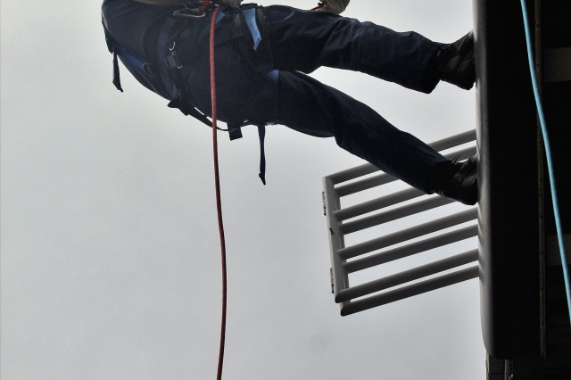 A firefighter with the Directorate of Emergency Services (DES) Fire Department practices rappelling down a tower May 10, 2018, at the Air Assault Course at Fort McCoy, Wis., during Ropes Rescue I training. The course is the first of many for the firefighters in technical rescue training. The DES Fire Department stepped up the department's training in technical rescue in 2014. Technical rescue is defined as those aspects of saving life or property that employ the use of tools and skills that exceed those normally used in firefighting, medical emergency, and rescue. (U.S. Army Photo by Scott T. Sturkol, Public Affairs Office, Fort McCoy, Wis.)