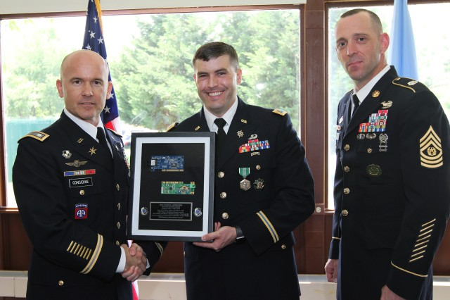 FORT GEORGE G. MEADE, Md. -- Maj. Brooks Jarnagin (center) receives a plaque from Lt. Col. Justin Considine (left), commander of the 781st Military Intelligence Battalion (Cyber) and the executive agent for the Army Intelligence Development Program -- Cyber (AIDP-Cyber), and 781st MI Bn. Command Sgt. Maj. Jesse Potter, after graduating from the AIDP-Cyber course in a ceremony at the National Cryptologic Museum here on June 1.