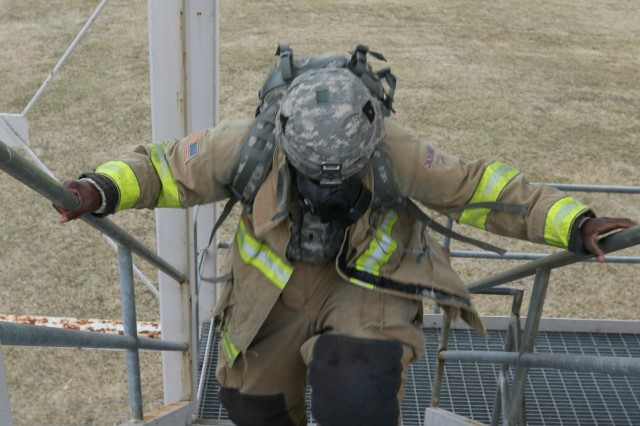 A Soldier  from 6th General Support Aviation Battalion, 101st Aviation Regiment, 101st Combat Aviation Brigade, 101st Airborne Division, moves quickly up the stairs of a tower during the 9/11 Memorial Relay Race, February 6, 2018. The relay was one of several events during a three-day training exercise designed to certify leadership competencies, instill esprit de corps and a winning mindset. (Photo by Staff Sgt. Todd Pouliot, 40th Public Affairs Detachment)