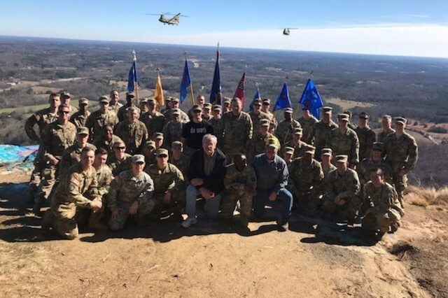 Junior officers, company command teams, and primary staff from 6th General Support Aviation Battalion, 101st Aviation Regiment, 101st Combat Aviation Brigade, 101st Airborne Division, gather for a photo with veterans, atop Currahee Mountain, near Toccoa, Georgia, the birthplace of the 101st, February, 7, 2018. The trip to Currahee Mountain culminated a three-day training exercise for the battalion's junior officers designed to instill esprit de corps, and recall the history and legacy of the 101st Airborne Division. (U.S. Army photo)