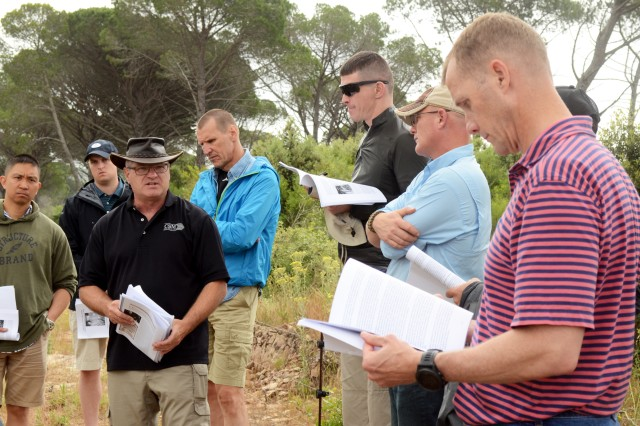 Ernest Roth (center), a retired Army command sergeant major, military historian and staff ride facilitator, describes the area where paratroopers landed during WWII Operation Anvil-Dragoon May 28, 2018. Anvil-Dragoon was the campaign to take Southern France August 15, 1944. Junior and senior leaders from the Joint Multinational Readiness Center, Hohenfels, Germany, participated in a battle staff ride, which retraced the actual landing spots and troop movements in Southern France, May 27 - 31.