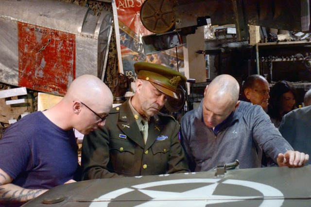 Sgt. 1st Class Edward Jervis (left) and Lt. Col. Richard Towner (right) view WWII historical documents and photographs with Lidy Gabriel, a WWII role player, at a privately owned WWII Memorabilia Museum in Roynac, France, as Operation Anvil-Dragoon was discussed May 30, 2018. Anvil-Dragoon was the campaign to take Southern France August 15, 1944. Junior and senior leaders from the Joint Multinational Readiness Center, Hohenfels, Germany, participated in a battle staff ride, which retraced the actual landing spots and troop movements in Southern France, May 27 -- 31.