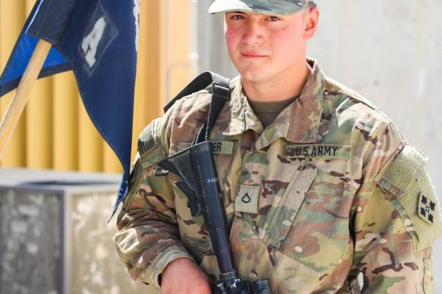 Pfc. Trenton Kreuger, an infantryman assigned to Alpha Company, 2nd Battalion, 12th Infantry Regiment, 2nd Infantry Brigade Combat Team, 4th Infantry Division, poses for photo in Kandahar, Afghanistan, June 1, 2018. Kreuger is in the same battalion and brigade his father, former Sgt. Michael Kreuger.