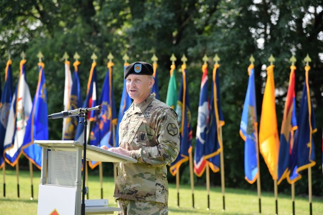 "New U.S. Army Garrison Rheinland-Pfalz Command Sgt. Maj. D. ""Brett"" Waterhouse speaks to audience members during an assumption of responsibility ceremony at Rhine Ordnance Barracks, June 6. Waterhouse brings 27 years of training and experience to the garrison's highest noncommissioned officer position."