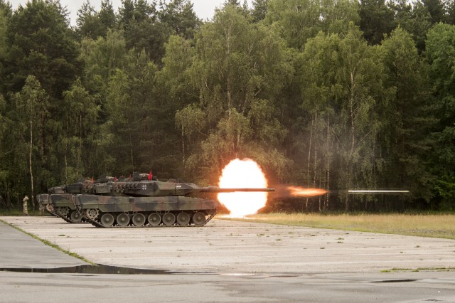 A German Leopard 2A6 tank fires at its target during the calibration range during Strong Europe Best Tank. U.S. Army Europe and the German Army co-host the third Strong Europe Tank Challenge at Grafenwoehr Training Area, June 3 - 8, 2018.