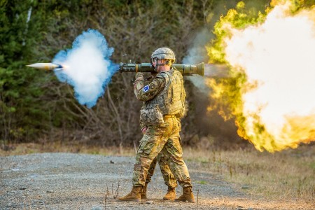 Montana Army National Guard Soldier fires a M136E1 AT4-CS confined light anti-armor weapon while competing in the National Guard Best Warrior Region VI 2018 at Joint Base Elmendorf-Richardson, Alaska, May 15, 2018.