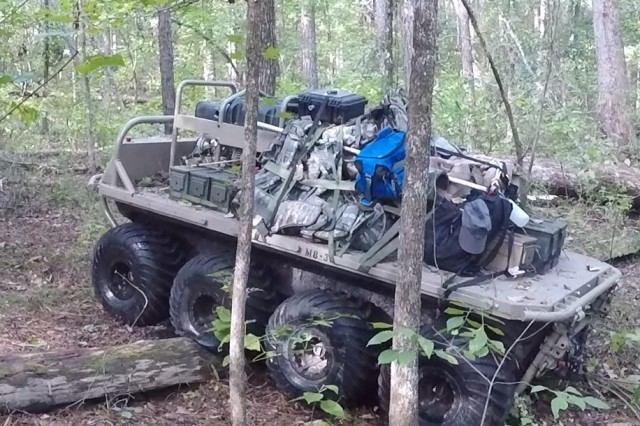 The SMET system developed by General Dynamics Land Systems (GDLS) negotiates terrain during the SMET Phase I Assessment in September at Fort Benning, Georgia. GDLS' system is one of four chosen for the Phase II technology demonstration. Also taking part are HDT Global, Howe and Howe Technologies Inc. and Team Polaris
