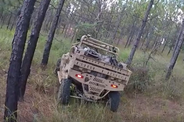 The system developed by Team Polaris moves through woods at Fort Benning, Georgia. The SMET Phase II technology demonstration strategy calls for issuing 16 systems from each of the final four designs to IBCTs that will train with the systems for one year.