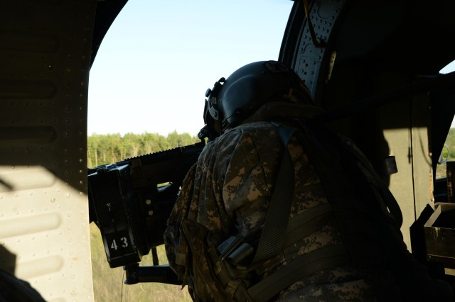 A New York Army National Guard Soldier assigned to 3rd Battalion, 142nd Aviation, fires a M240 from a UH-60 Blackhawk Helicopter, over Fort Drum, N.Y., June 2nd, 2018. Soldiers from the 3-142 were conducting Aerial Gunnery training during their monthly drill to prepare for an event at the National Training Center, Fort Irwin, C.A.