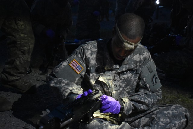 New York Army National Guard Pfc. Arthur Allen, assigned to the 3rd Battalion, 142nd Aviation, cleans a M240 on Fort Drum, N.Y., June 2nd, 2018. Allen had conducted Aerial Gunnery training for his monthly drill, qualifying to prepare for a training event at the National Training Center, Fort Irwin, C.A.