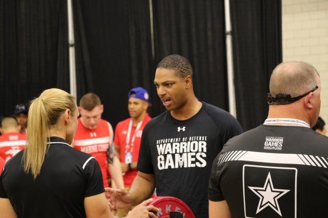 U.S. Army Sgt. Samuel Daniels gets instruction from coach Adriane Wilson during warm ups before the powerlifting competition June 5, 2018, in the U.S. Air Force Academy's Cadet Gymnasium at the 2018 Department of Defense Warrior Games. The DoD Warrior Games are conducted from June 2 - 9. It is an adaptive sports competition for wounded, ill and injured service members and veterans. Approximately 300 athletes representing teams from the Army, Marine Corps, Navy, Air Force, Special Operations Command, United Kingdom Armed Forces, Canadian Armed Forces, and the Australian Defence Force will compete in archery, cycling, track, field, shooting, sitting volleyball, swimming, wheelchair basketball, and - new this year - powerlifting and indoor rowing. (U.S. Army photo by Robert Whetstone)