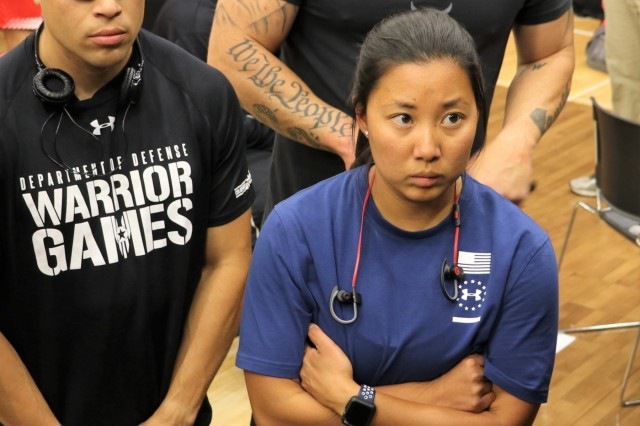 U.S. Army Sgt. 1st Class Hyoshin Cha listens intently to instruction before the powerlifting competition June 5, 2018, in the U.S. Air Force Academy's Cadet Gymnasium at the 2018 Department of Defense Warrior Games. The DoD Warrior Games are conducted from June 2 - 9. It is an adaptive sports competition for wounded, ill and injured service members and veterans. Approximately 300 athletes representing teams from the Army, Marine Corps, Navy, Air Force, Special Operations Command, United Kingdom Armed Forces, Canadian Armed Forces, and the Australian Defence Force will compete in archery, cycling, track, field, shooting, sitting volleyball, swimming, wheelchair basketball, and - new this year - powerlifting and indoor rowing. (U.S. Army photo by Robert Whetstone)