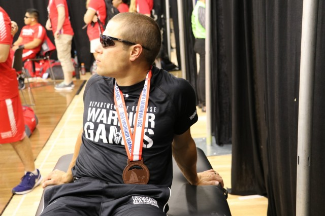 U.S. Army Sgt. Jonathan Weasner won the bronze medal in his weight class during the powerlifting competition June 5, 2018, in the U.S. Air Force Academy's Cadet Gymnasium at the 2018 Department of Defense Warrior Games. The DoD Warrior Games are conducted from June 2 - 9. It is an adaptive sports competition for wounded, ill and injured service members and veterans. Approximately 300 athletes representing teams from the Army, Marine Corps, Navy, Air Force, Special Operations Command, United Kingdom Armed Forces, Canadian Armed Forces, and the Australian Defence Force will compete in archery, cycling, track, field, shooting, sitting volleyball, swimming, wheelchair basketball, and - new this year - powerlifting and indoor rowing. (U.S. Army photo by Robert Whetstone)