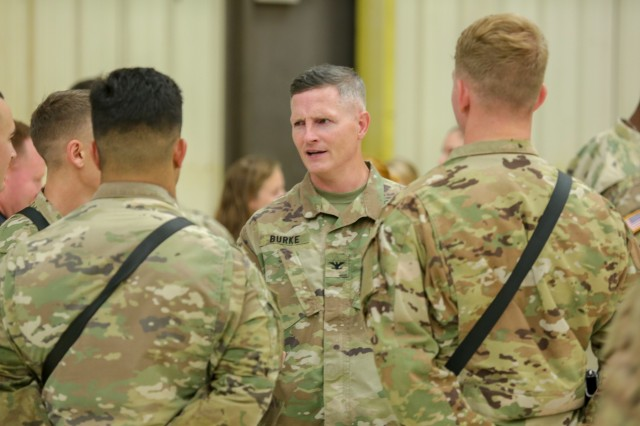 Col. Thomas Burke, Commander of the 25th Combat Aviation Brigade, speaks to soldiers of Bravo Company 'Hillclimbers' during a deployment ceremony on Wheeler Army Airfield Jun 5. The 'Hillclimbers' will support Operation Freedom's Sentinel and Operation Resolute Support in the CENTCOM area of responsibility for nine months.