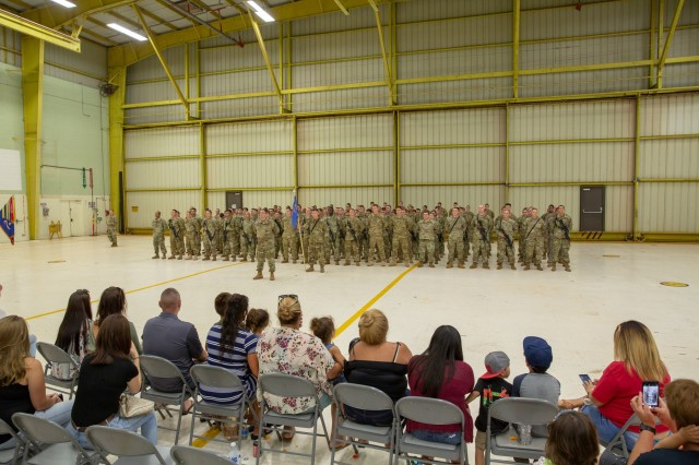 Bravo Company 'Hillclimbers', 3-25 Aviation Regiment, stand in formation before their families during a deployment ceremony at Wheeler Army Airfield Jun. 5. The 'Hillclimbers' will support Operation Freedom's Sentinel and Operation Resolute Support in the CENTCOM area of responsibility for nine months.