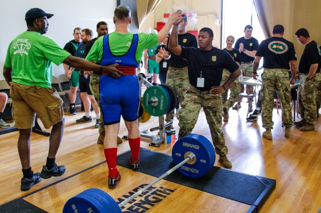 A volunteer from the 1st Special Forces Group (Airborne) congratulates a Special Olympics athlete after a successful deadlift at Evergreen Theater on Joint Base Lewis-McChord during the Washington State Special Olympics Powerlifting event, June 2. Soldiers from 4th Battalion, 1st SFG (A) volunteered to host the Washington State Special Olympics Powerlifting event for the third year in a row.
