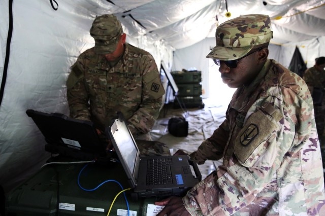 U.S. Army Spc. Xavier Palacios, assigned to Bravo Company, 44th Expeditionary Signal Battalion, 2nd Theater Signal Brigade, and U.S. Army Spc. Trey Whitney, assigned to Bravo Company, 151st Expeditionary Signal Battalion, 228th Theater Tactical Signal Brigade, South Carolina National Guard, troubleshoot a Command Post Node switch, June 5, 2018, in Boleslaweic, Poland.