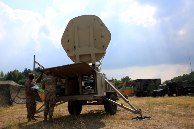 U.S. Army Spc. Rodderick Pace (left) and Spc. Zane Trimback, both assigned to Bravo Company, 44th Expeditionary Signal Battalion, 2nd Theater Signal Brigade, set up a Satellite Transportable Terminal to provide communications support to exercise Saber Strike, June 2, 2018 in the Drawsko Pomorskie Training Area, Poland.