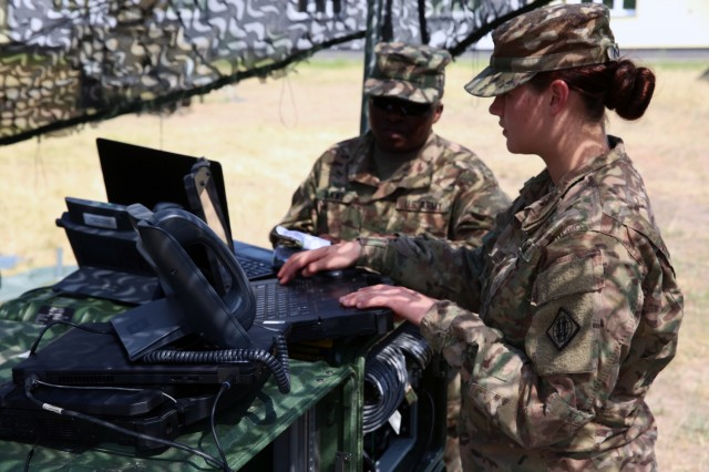 U.S. Army Pfc. Attalissa Mooney and Sgt. Bonam Sakwe, both assigned to Bravo Company, 44th Expeditionary Signal Battalion, 2nd Theater Signal Brigade, set up a Command Post Node to provide communications support to exercise Saber Strike, June 2, 2018 in the Drawsko Pomorskie Training Area, Poland.