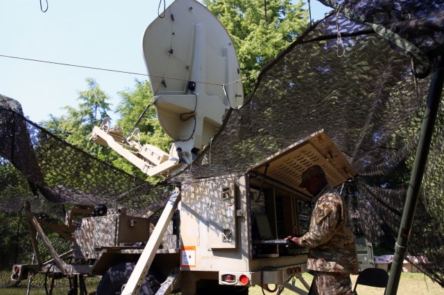 U.S. Army Spc. Demitrius Portalatin, assigned to Bravo Company, 44th Expeditionary Signal Battalion, 2nd Theater Signal Briagde, adjusts the settings on a Satellite Transportable Terminal providing communications support to exercise Saber Strike, June 4, 2018, near Powidz, Poland. Saber Strike is a U.S. Army Europe-led exercise involving approximately 18,000 Soldiers from 19 participating nations taking place in Lithuania, Estonia, Latvia and Poland from June 3-15, 2018.