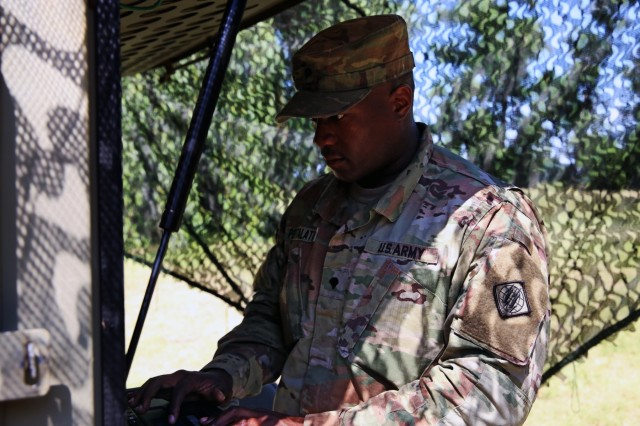 U.S. Army Spc. Demitrius Portalatin, assigned to Bravo Company, 44th Expeditionary Signal Battalion, 2nd Theater Signal Briagde, adjusts the settings on a Satellite Transportable Terminal providing communications support to exercise Saber Strike, June 4, 2018 near Powidz, Poland. Saber Strike is a U.S. Army Europe-led exercise involving approximately 18,000 Soldiers from 19 participating nations taking place in Lithuania, Estonia, Latvia and Poland from June 3-15, 2018.
