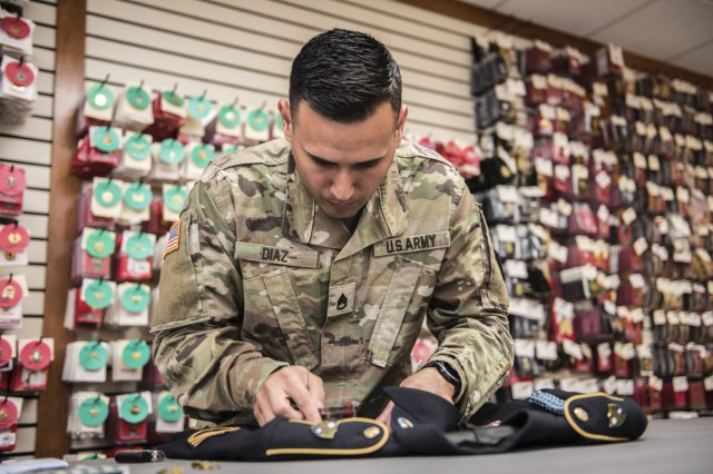 Army Reserve Staff Sergeant Luis Diaz assembles a dress uniform for use during mortuary affairs operations at the Charles C. Carson Center, located at Dover Air Force Base in Dover, Del., Oct. 24, 2017. The Charles C. Carson Center is home to the Port Mortuary, which is responsible for returning all Department of Defense service members, civilians, and contractors who perish during contingency operations overseas.