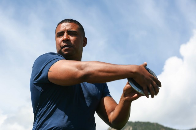U.S. Army Sgt. 1st Class Julio Rodriguez, a competitor in the 2018 Warrior Games, prepares to throw his disc as part of the field event at the United States Air Force Academy, Colorado Springs, Colorado, May 28, 2018. The DoD Warrior Games is an adaptive sports competition for wounded, ill and injured service members and veterans. Approximately 300 athletes representing teams from the Army, Marine Corps, Navy, Air Force, Special Operations Command, United Kingdom Armed Forces, Canadian Armed Forces, and the Australian Defense Force will compete June 1 - June 9 in archery, cycling, track, field, sitting, sitting volleyball, swimming, wheelchair basketball, powerlifting, and indoor rowing. (U.S. Army Photo by Spc. Caitlyn Cassidy)