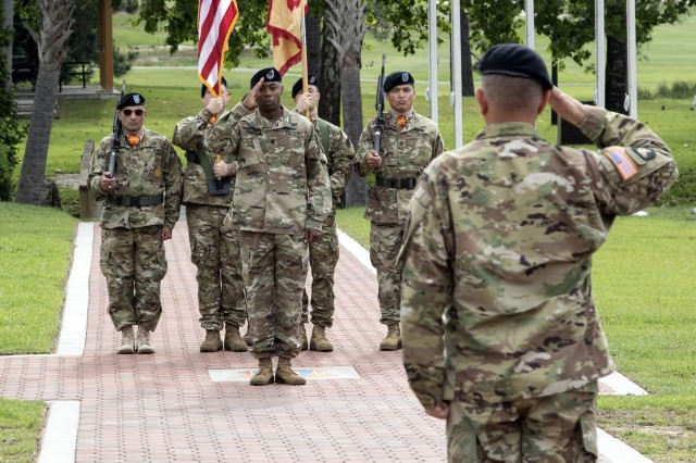 Command Sgt. Maj. Anthony Wilson, Garrison senior enlisted leader, salutes Col. Stephen Elder, Garrison commander after assuming responsibility for the unit during a change of responsibility ceremony at Victory Field June 5.
