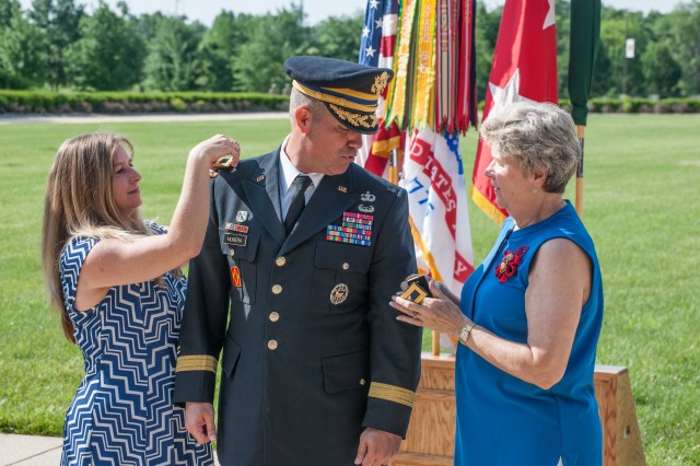 Tacy, left, spouse of Brig. Gen. Antonio Munera and Barbara, his mother, pin on the rank of brigadier general to his uniform during a promotion ceremony held May 30 on the Maneuver Support Center of Excellence Plaza.