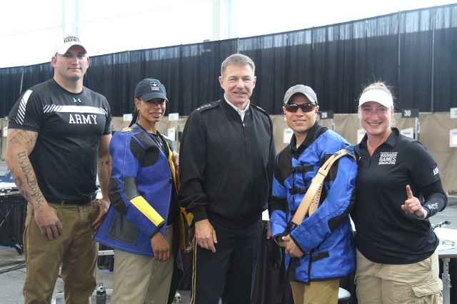 U.S. Army Gen. James McConville, Vice Chief of Staff of the Army, poses for a photo with members of Team Army before the shooting event, Colorado Springs, Colorado, June 2, 2018.
